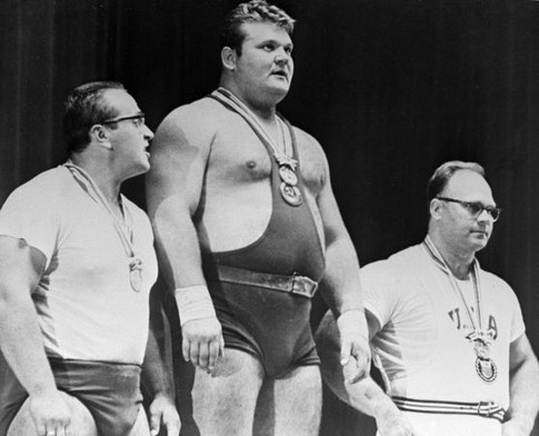 Soviet weightlifters  Yury Vlasov,  Leonid Zhabotinsky  and American weightlifter   Norbert Schemansky (left to right) during the ceremony of   presenting awards at the 18th Olympic Games in Tokyo.